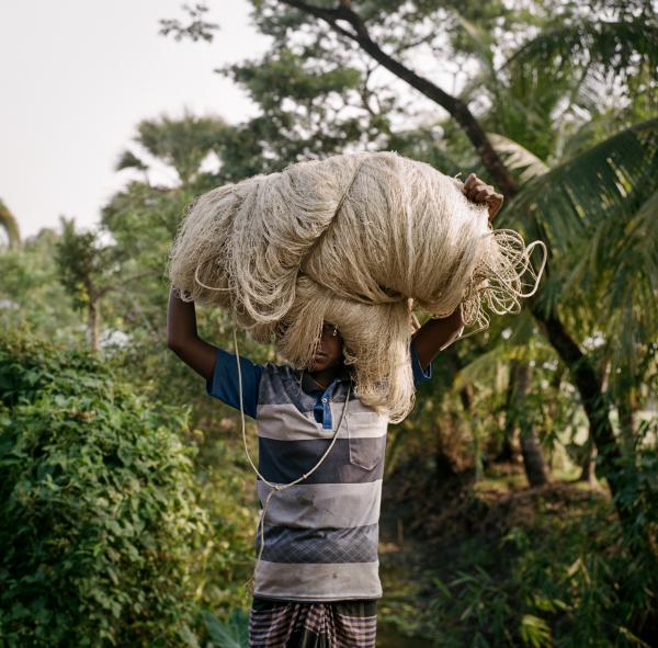 """A local carries fishing nets, made of plastic materials, which are often used only a few times and then disposed of, on May 14, 2019. Taken on assignment for National Geographic's """"Sea to Source: Ganges"""" expedition. Through the expedition, the international, all-female team of scientists are working with National Geographic and international partners to scientifically document plastic waste in the Ganges watershed and support holistic and inclusive solutions."""
