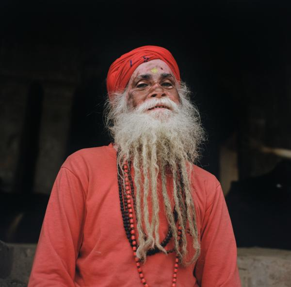 """Rajan Baba, a sadhu, poses for a portrait at Manikarnika ghat, his main location of meditgation, in Varanasi, India on Nov. 25, 2019. Rajan Baba believes that nowadays """"people are spending less time exploring god and more time chasing after things...I've been born and brough up in Banaras, a lot has changed...[the Ganges] used to be much wider...as the waste has increased, the water has shunk...what else would I want but that the water becomes clean again?"""" he said. Taken on assignment for National Geographic"""