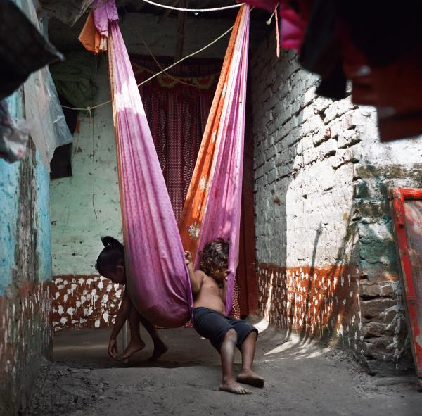 Sita Ram Sahni's grandchildren play at their home in a makeshift swing in the village of Rasalpur, Dharnipatti, Bihar on Nov. 17, 2019. Taken on assignment for National Geographic