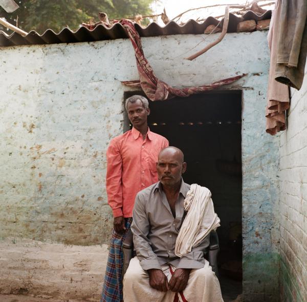 Fishermen Sita Ram Sahni, 70, and Vinod Sahni, 50, pose for a portrait outside of their home in Rasalpur, Dharnipatti, Bihar on Nov. 13, 2019. Taken on assignment for National Geographic