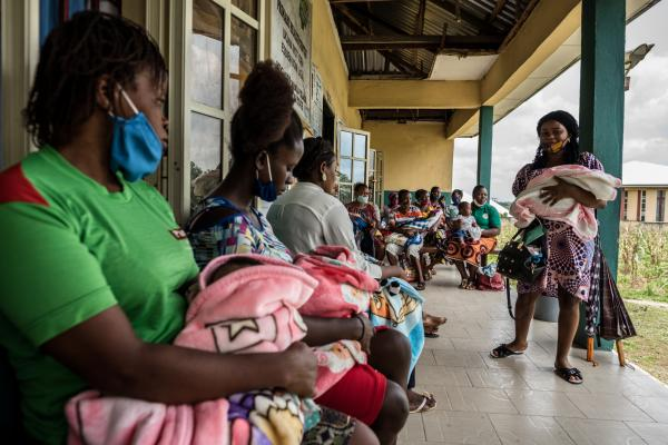 Nursing mothers wait to take their children into the outpatient room to seek medical care.