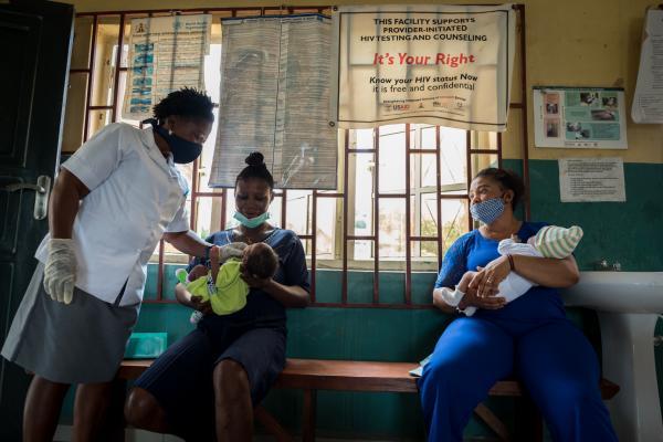 A nurse prepares to immunize a child.