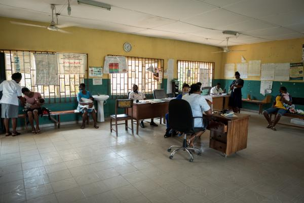 Various medical staff attend to some nursing mothers in the outpatient room at the Primary Health centre in Ukana.