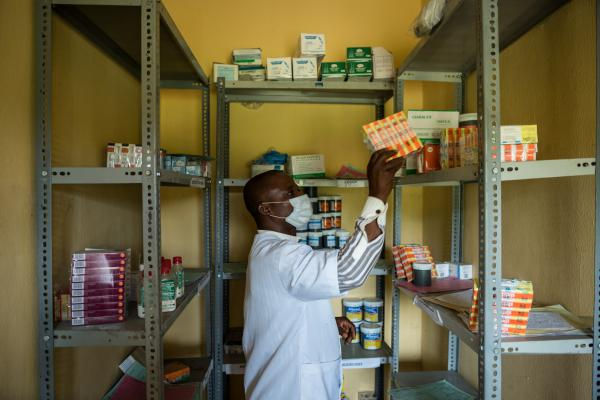 Charles Udoh, a pharmacy technician takes stock of drugs in the drug store at the Primary Health centre in Ukana which is managed by the Community Based Health Initiative program