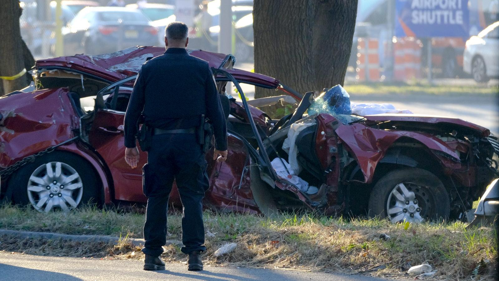 Queens - October 6, 2020 - NYPD ESU, Highway and 106th Precinct Officer is seen investigating a single car accident at 102nd Street and North Conduit Avenue near JFK Airport early Tuesday morning. Three unidentified people died in the accident. (Luiz C. Ribeiro for New York Daily News)