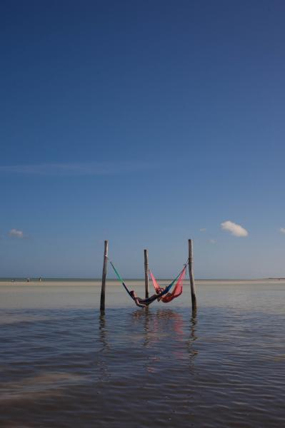 Tourists relax on a hammock in the ocean in Isla Holbox, Mexico. CREDIT: Alicia Vera for The Wall Street Journal. HOLBOX