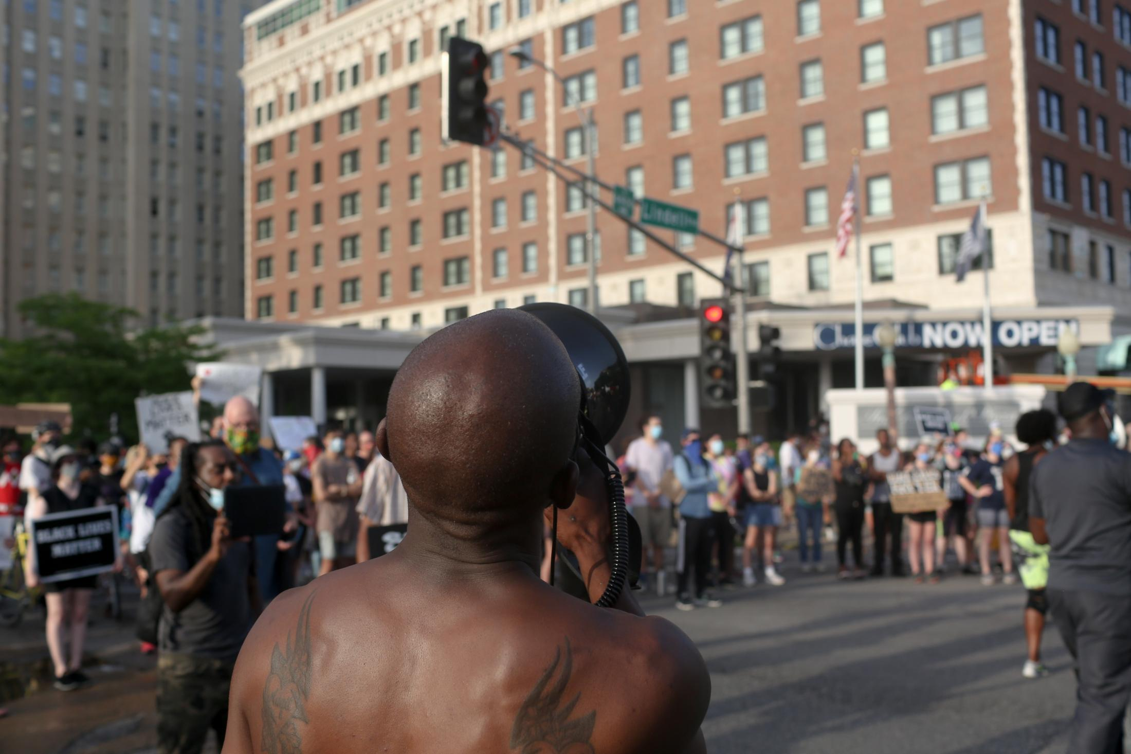 A protesters chants into a mega phone in front of the Ritz-Carlton Hotel on June 28, 2020 in St. Louis, Missouri. Two protest marches merged on Kingshighway in the Central West End neighborhood of St. Louis and planned on marching to the St. Louis mayor's house.
