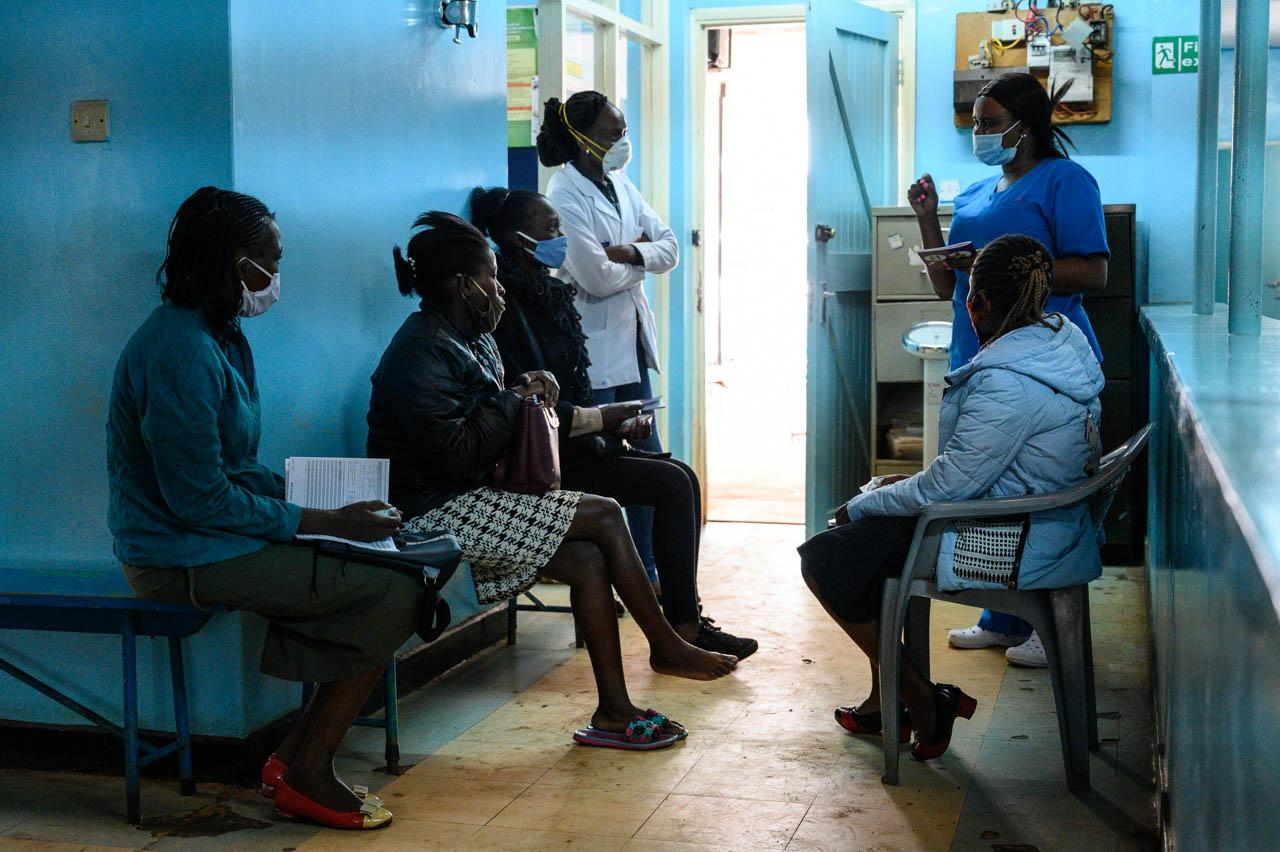 Interning clinical officer Pauline Nifah Otieno (in white coat) and Nurse Grace Ireri (far right) hold their daily talk on antenatal care for first time mothers at Waithaka Health Centre in Nairobi.