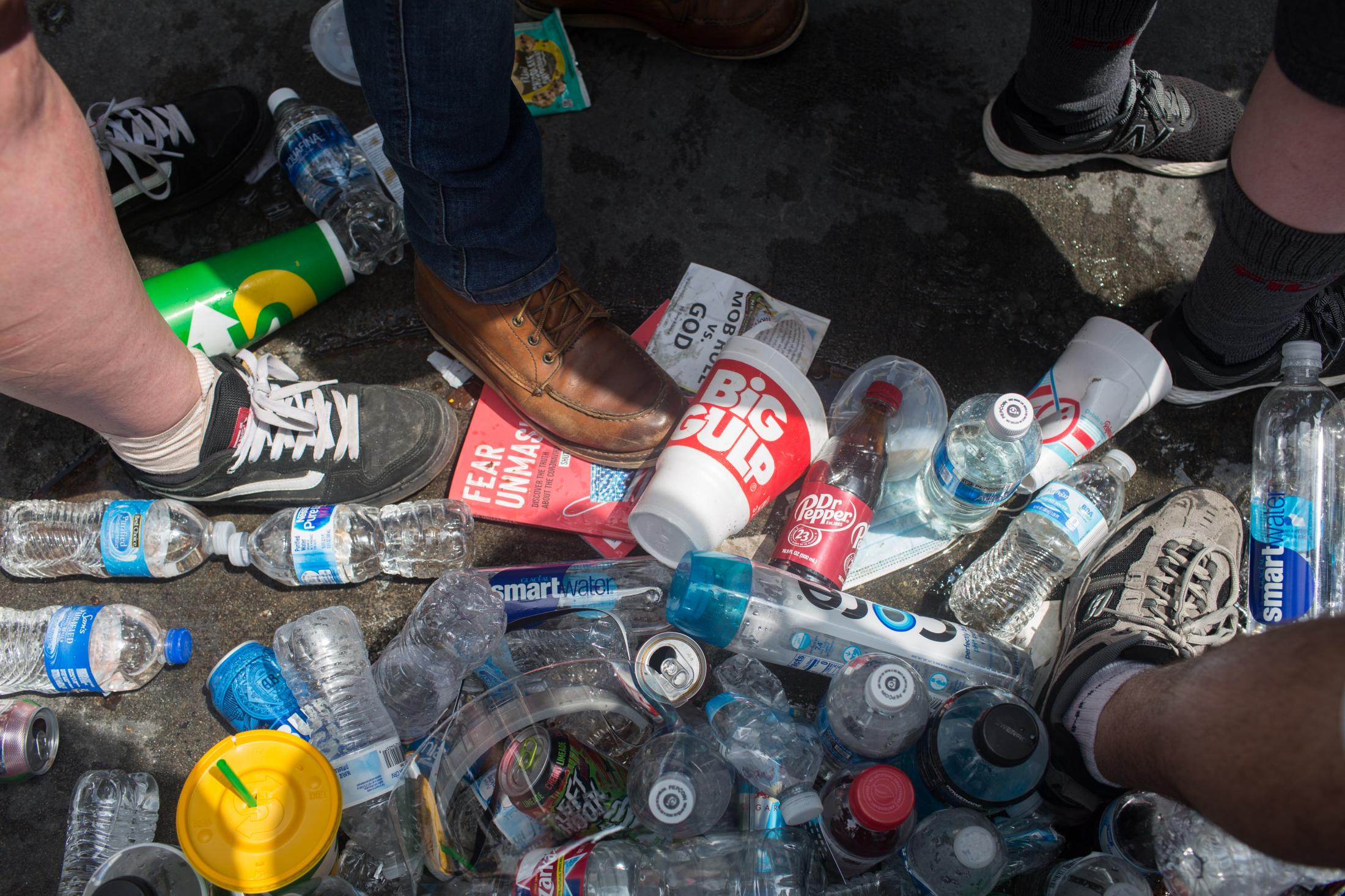 Trash is piled up in front of barricades set up at the 4th Street entrance to the BOK Center in Tulsa before the start of Donald Trump's campaign rally on June 20, 2020. Trash was left behind as people walking through security were told they could not bring in certain items.