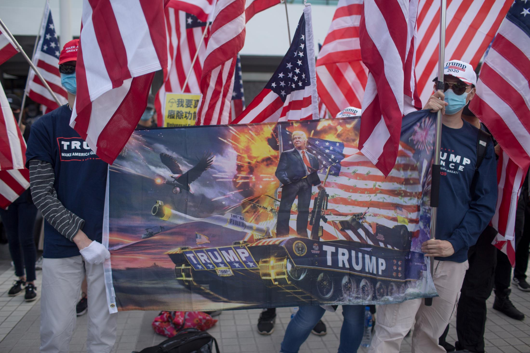 A group marched with United States flags and pro-Trump make America great again merchandise at Edinburgh Place in Central Hong Kong on January 12, 2020, during the Karma to Commies pre-march assembly.