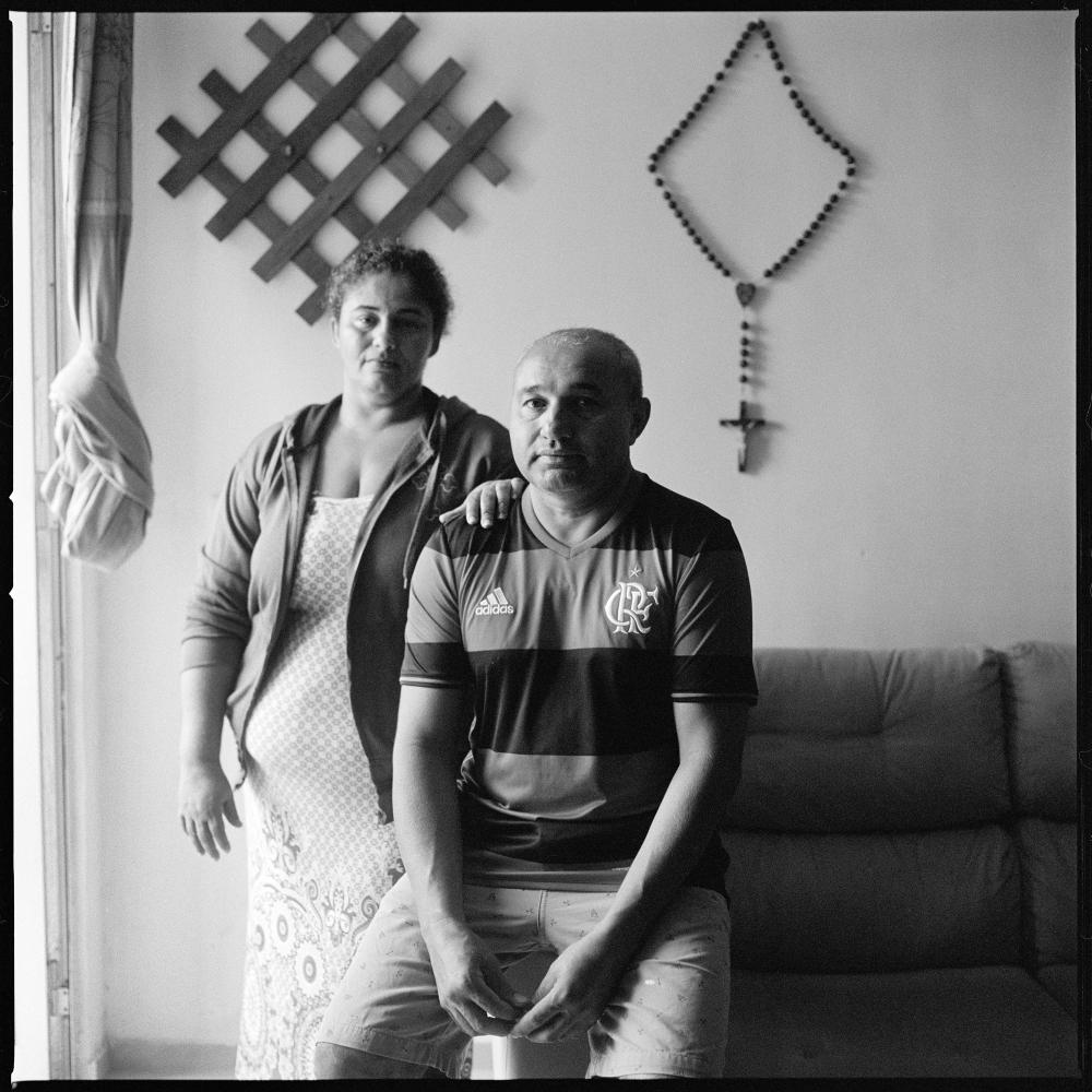 Carmelia Marques 43 with her husband Mussolino Araujo de Lima 51, former residents of Villa Autodromo favela in their new home in Parque Carioca, a housing complex in the western part of Rio which is mostly controlled by paramilitary forces.