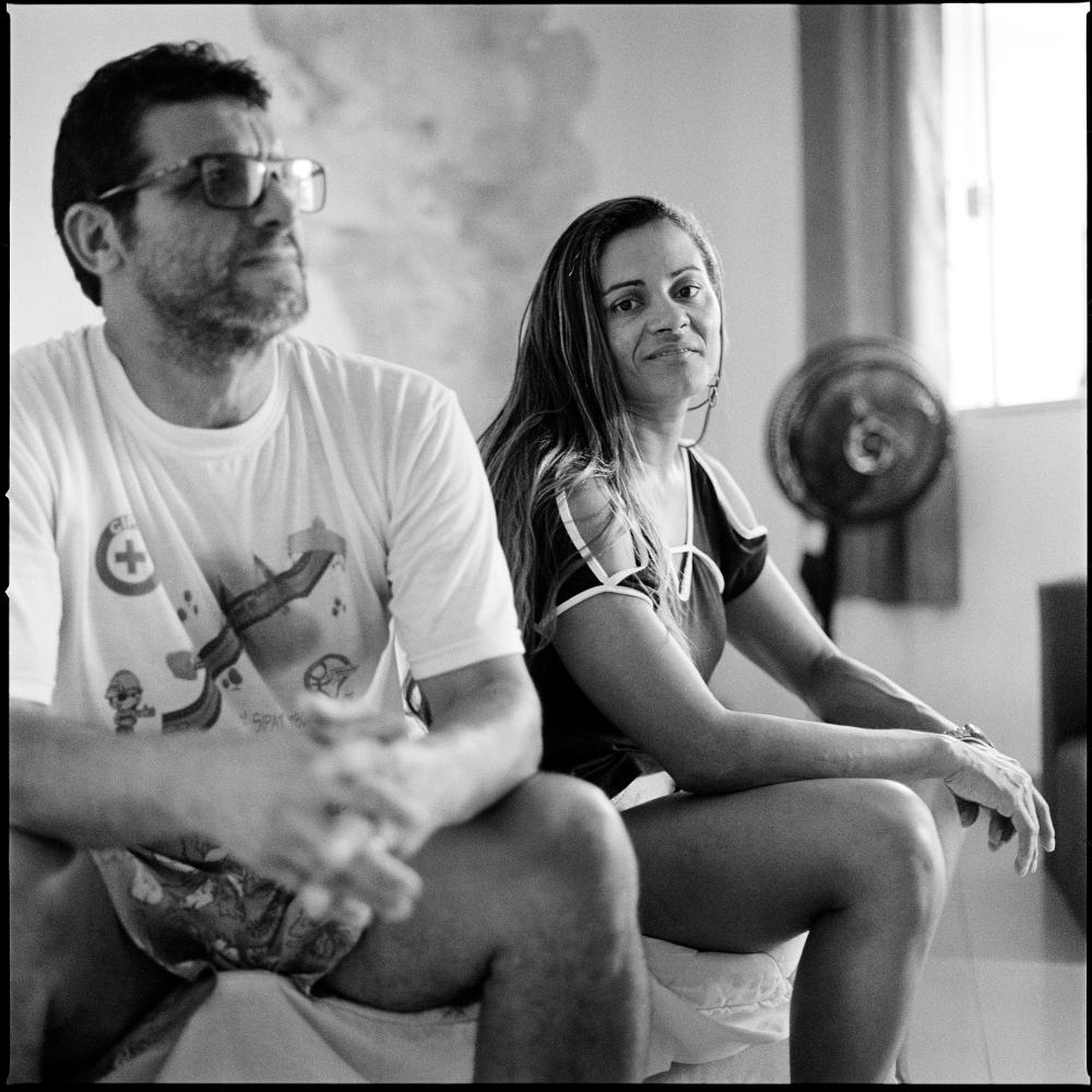 Lucineide Nicassio da Silva, 44 with her husband Fred in their home in Colonia, a community in western Rio de Janeiro where they built several houses after receiving compensation from the city of Rio de Janeiro to move out of their previous home in Vila Autodromo favela.