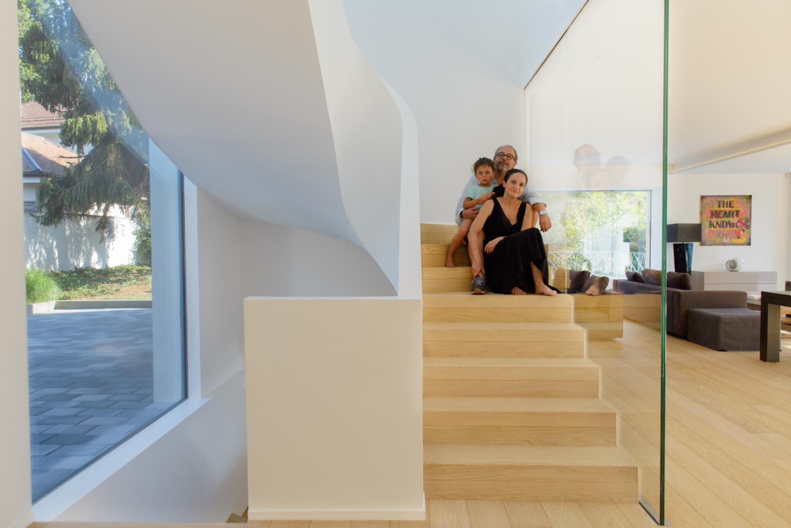 A family poses for a portrait in their home, designed by the architect Tiffany Beriro. Geneva, Switwerland - July 19, 2018.