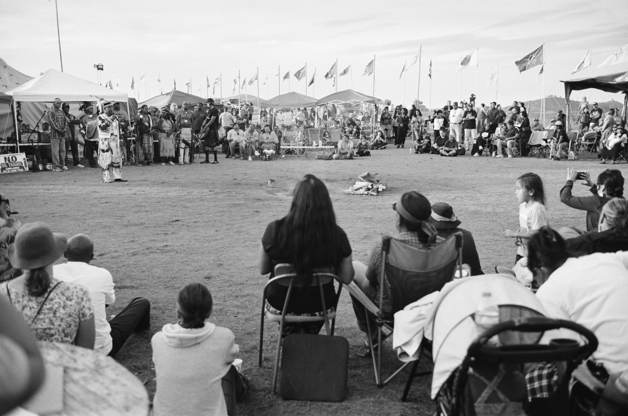 The sacred central fire at the heart of the Oceti Sakowin camp of the Standing Rock Sioux Tribe in North Dakota. A location that is in constant daily use for meals, prayer, talks, songs, dances, offerings, updates, lectures and humor.