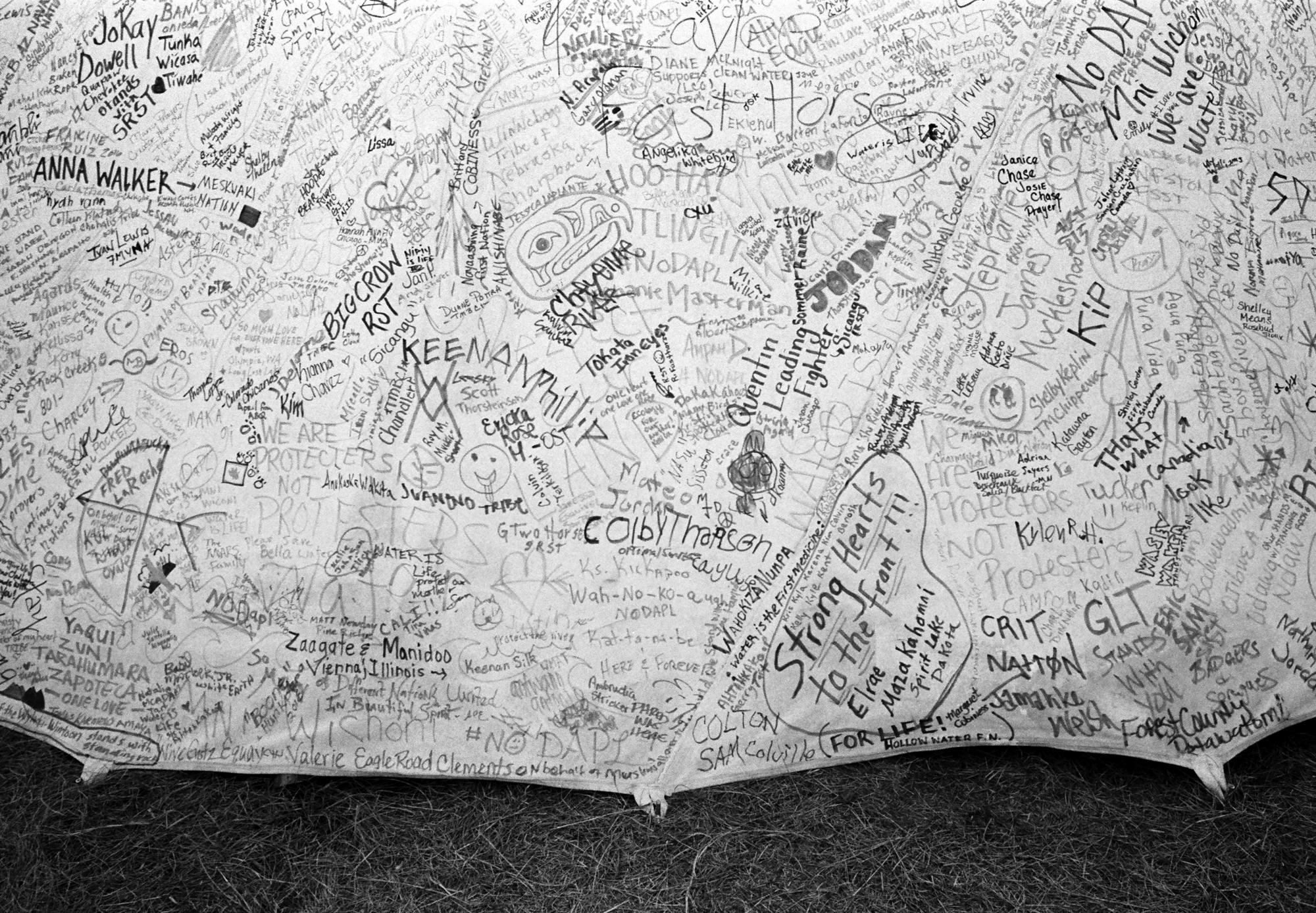 Detail of a tipi decorated with the messages of support from individuals and tribes around the world in the Oceti Sakowin camp of the Standing Rock Sioux Tribe in North Dakota.