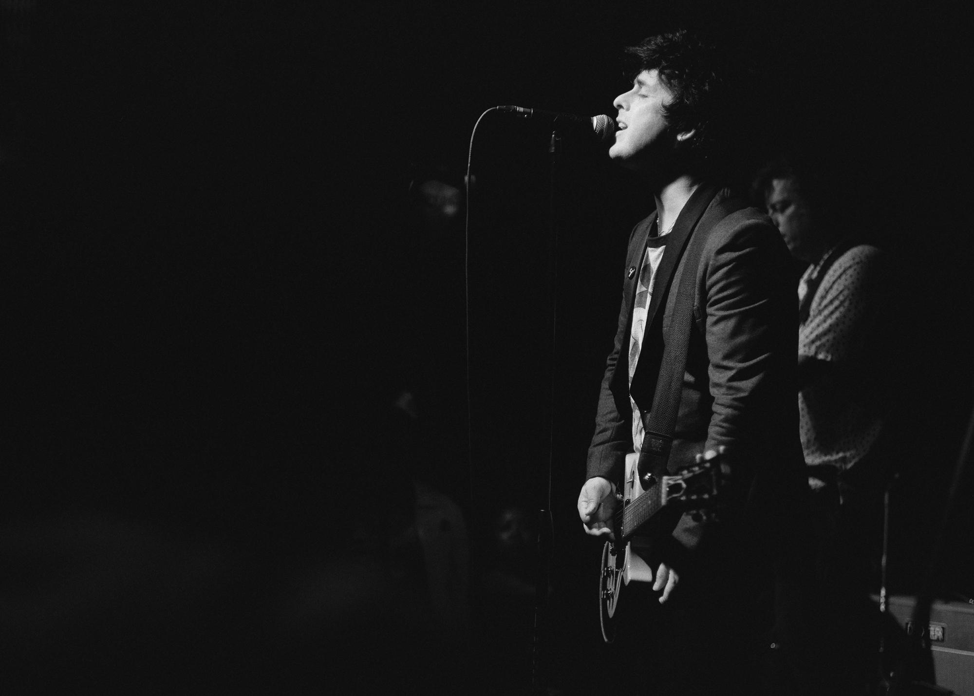 """Billie Joe Armstrong performing with his side project band """"The Coverups"""" onstage in Oakland at the small mighty rock venue of The Golden Bull bar. The Coverups played here on September 19, 2019, half a year before the Covid 19 pandemic proved so difficult to the income of the bar, that it temporarily shuttered it's doors. Now it's opened again, outside only, and planning to build a parklet in the city of Oakland."""