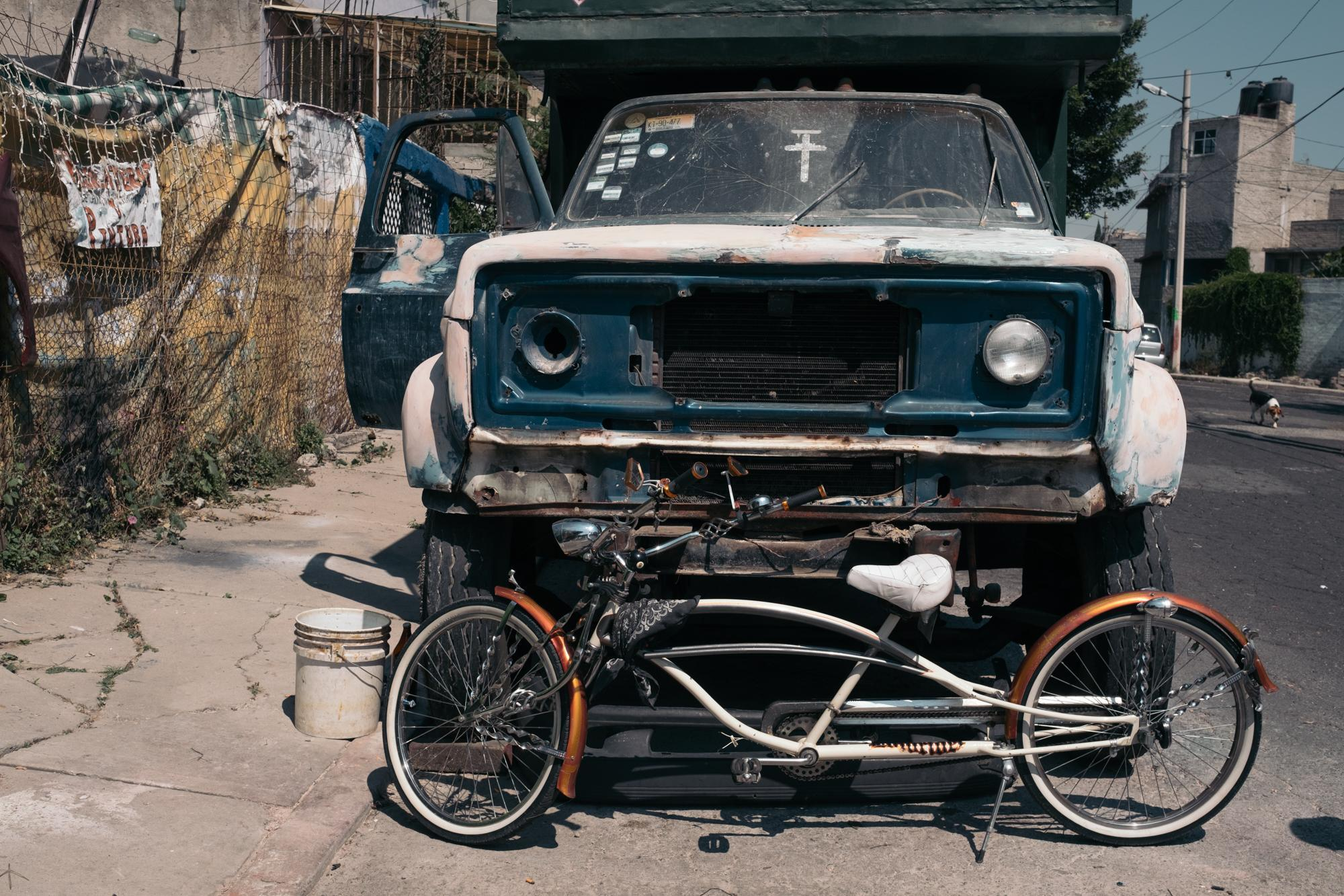 """Royer's """"Limo"""" bike parked in front of his house. The """"Limo"""" bikes are longer than regular ones. Each bike model has a particular name linked to its shape and size. Also, each owner assigns his bike a nickname. 30/10/2017 Ecatepec, Mexico State, Mexico."""
