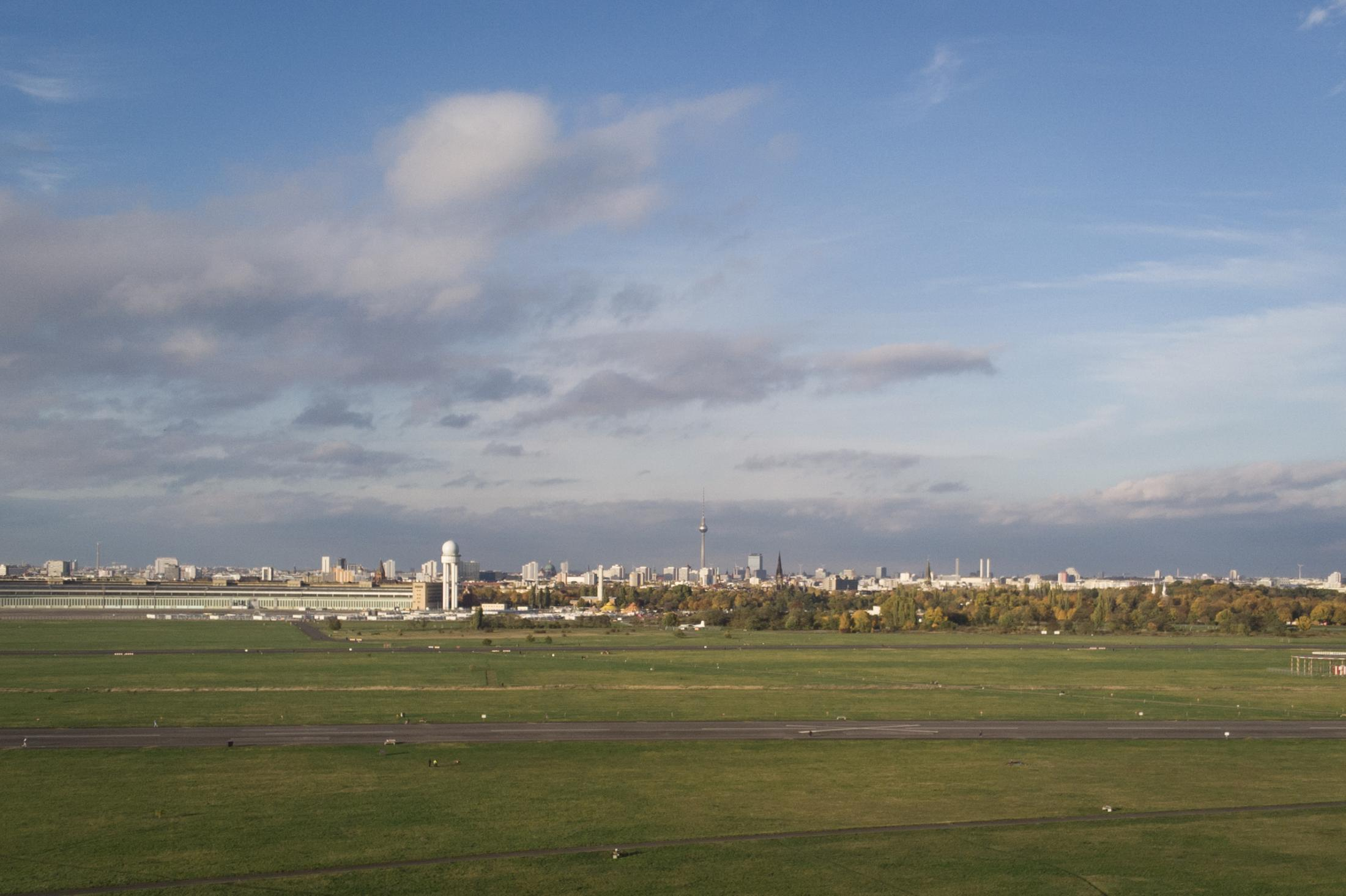 """Berlin is seen from above the former Tempelhof Airport (THF), which closed in 2008. The airfield now used for recreational purposes will be joined in retirement by that of Tegel Airport (TXL), which is due to shut down on November 8. A third airfield, that of Berlin's Schönefeld Airport (SXF), will be included in the new airport """"Berlin Brandenburg Willy Brandt"""" (BER), which finally opens this coming Saturday and which will be Berlin's only airport for the first time since 1934. Taken with a drone, October 28, 2020."""