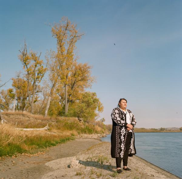 "Angeline Cheek an environmental activist poses for a portrait along the Missouri Rivers. ""This is our medicine"" she said, when speaking about the plants and herbs along the river that she worries would be contaminated by a pipeline spill."