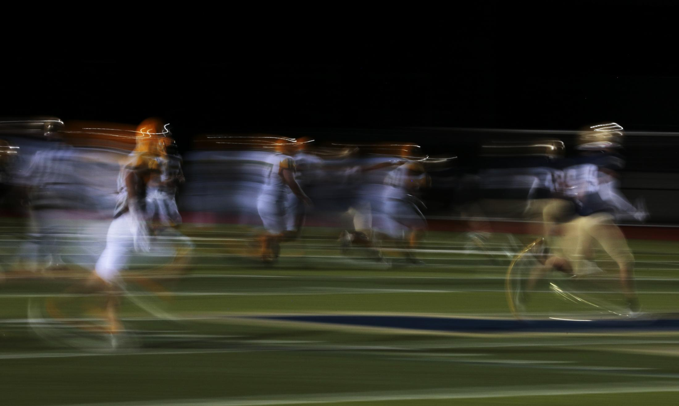 Helias Catholic High School players attempt to run a Rock Bridge High School player off the field on Sept. 25, 2020, in Jefferson City. The Bruins fell to the Crusaders 24-56.