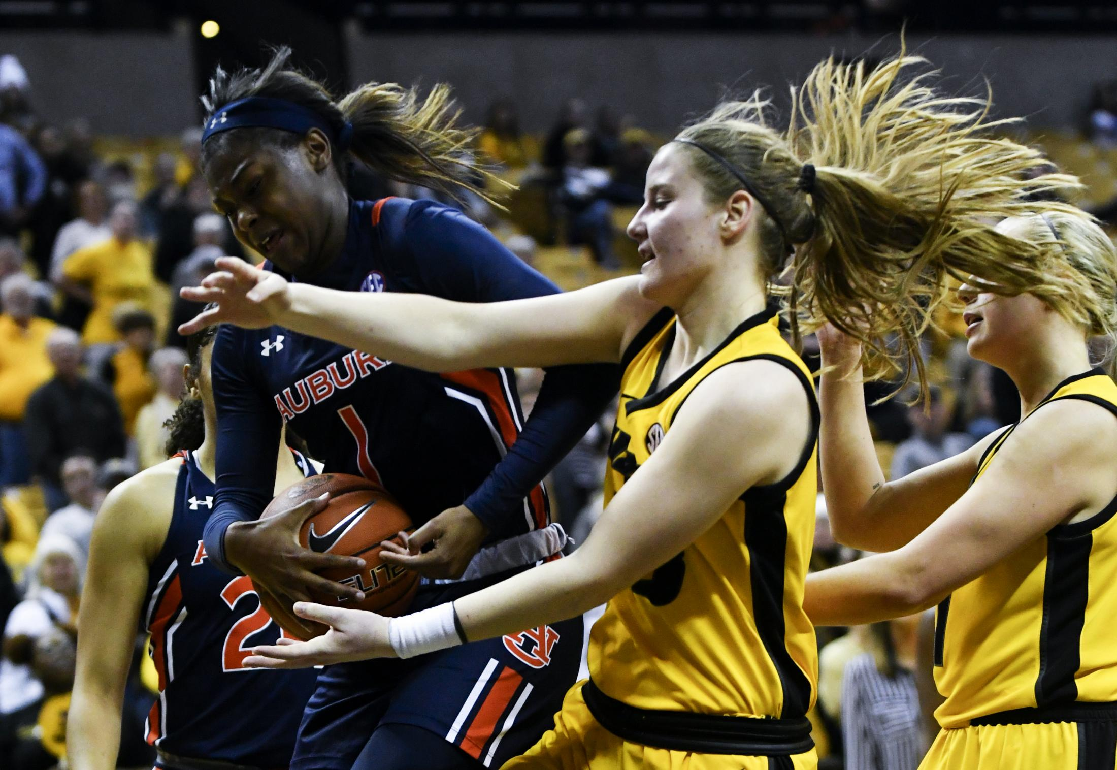 University of Missouri freshman Haley Frank attempts to steal the ball from Auburn University sophomore Robyn Benton on Feb. 27, 2020, at Mizzou Arena. Missouri lost to Auburn 95-82.
