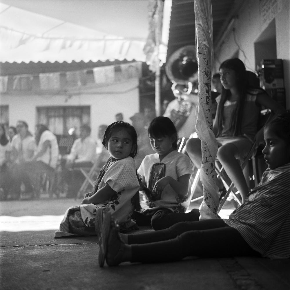 A group of little girls gathered to watch the traditional dances been performed at the Santa Cecilia celebration, Oaxaca City, November 2018.