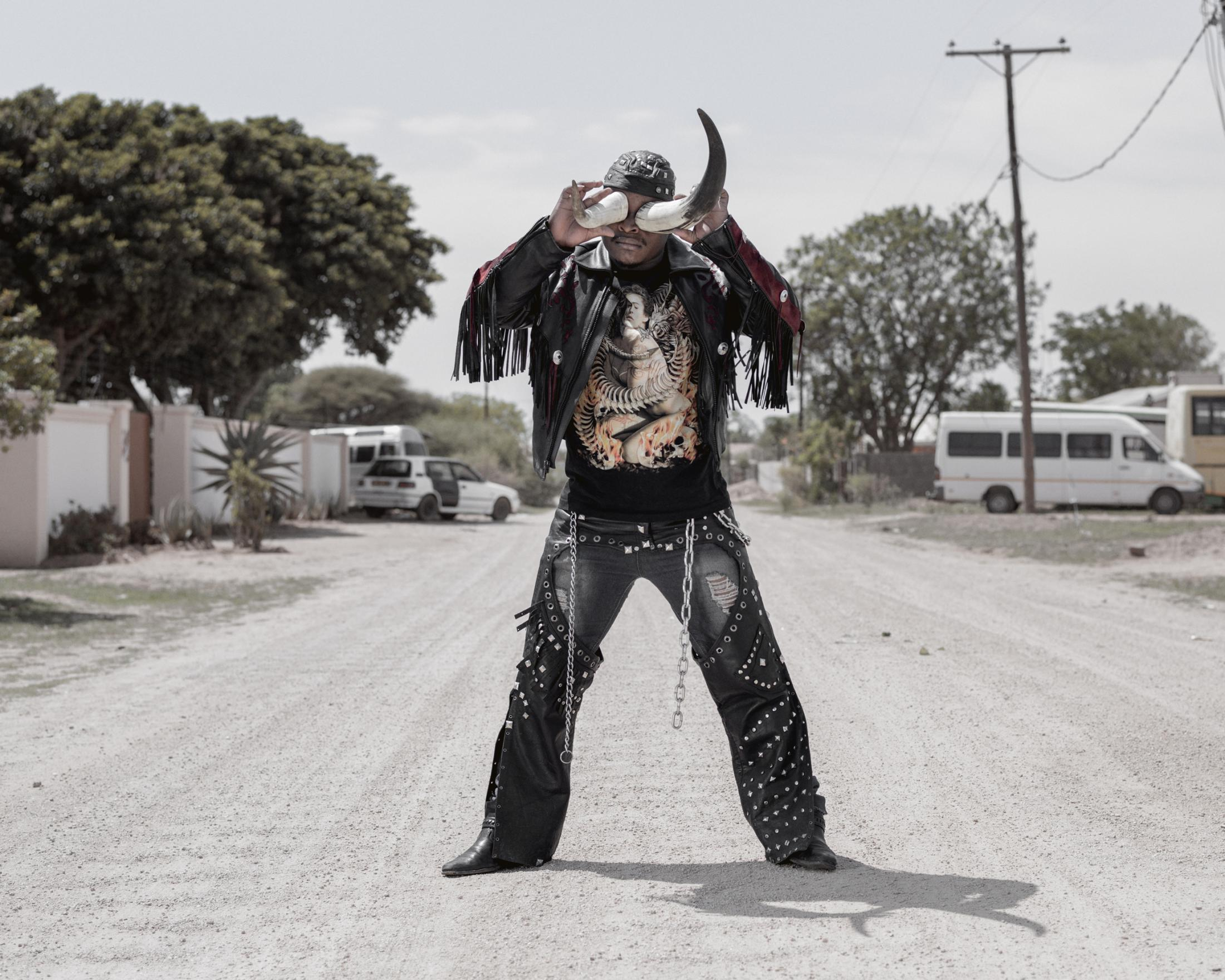 "Africa, Botswana, Gaborone, December 2015 Photo by Pep Bonet / NOOR Portrait of 27 years old ""Cybok"" I work as a security guard, I started listening to heavy metal in 2008, I liked the way the metal heads dressed and behaved so I started associating myself with them and I became a rocker, I like Skinflint, I'm new in the Industry."