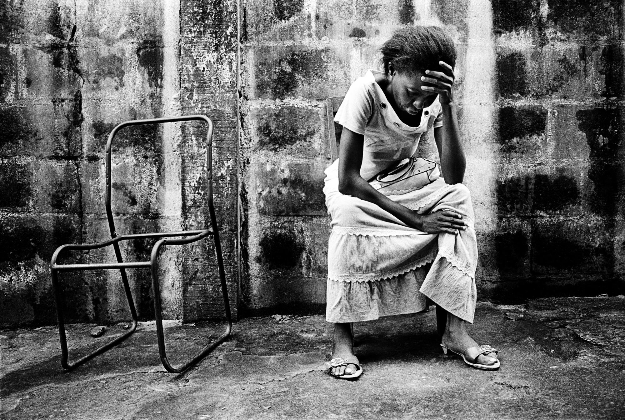 SIERRA LEONE Freetown A woman sits next to an empty chair at the City of Rest (CORE) drug rehabilitation centre. The Deliverance Ministry runs the centre, which offers counselling and support for recovering drug addicts, alcoholics and traumatised or delinquent youths. The ministry tries to address problems of addiction, delinquency and even cases of demonic possession with rest, food and prayer.
