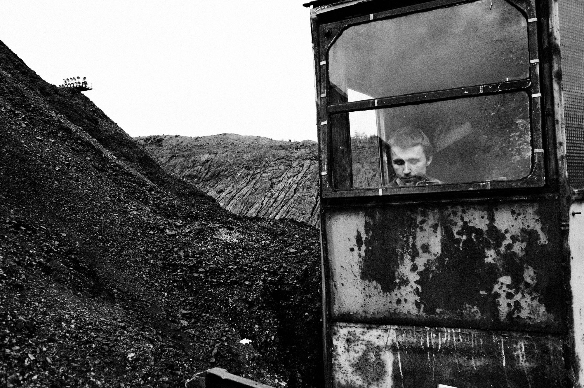 "Poland, Silesia Region, Zabrze. September 2009. Sosnica- Makoszowy Coal Mine. Portrait of a miner at work. Health and life of miners are often at risk. Sosnica- Makoszowy Coal Mine arose from merger of two mines, coal mine ""Sosnica"" in Gliwice and coal mine Makoszowy in Zabrze. Levels of mining can be found at a depth between 530 and 930 m. The ability of mining amounts about 12 000 tons per day, the mining area amounts 28,4 km2.. Nowadays 60% of polish energy comes from burning black coal, the biggest enemy of our climate. Poland is not one of the biggest countriest and doesnt have big population but contributes to climate change and is in first 20 countries that produce biggest amount of CO2. in 2004-2005 polish emmisions increases for more than 2 mln tones Whith China , Australia and Republic of South Africa , Poland belonges to countries that are most dependent on coal. Only 3% of polish energy comes from climate-friendly sources. Poland is Eupean leader in power industry energy-consuming . (Polish power industry consumes biggest amount of energy to produce energy)."