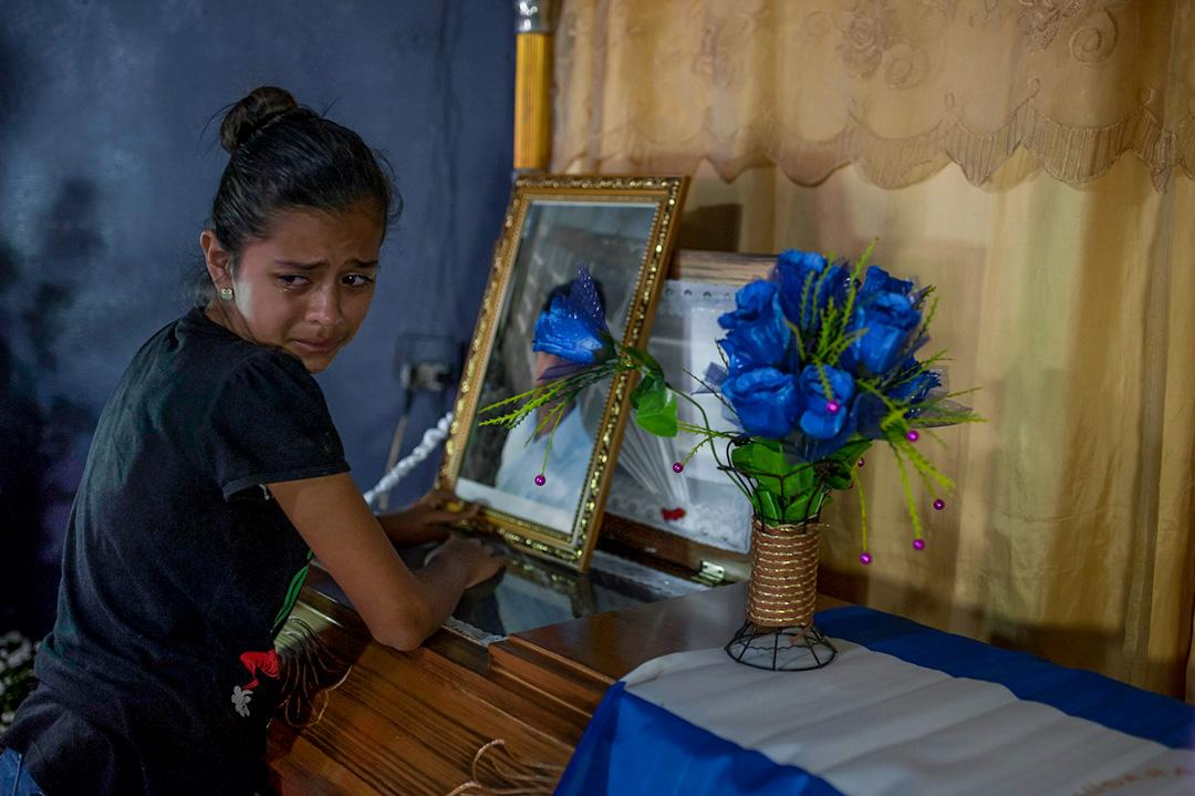 A relative cries on the coffin of Leyling Chavarria, who dead during clashes with members of Nicaragua´s special forces at the Sandino neighborhoods in Jinotega, more than 300 people have been killed since April 19, when demonstrations against the government of President Ortega erupted. Most were opponents of the regime.