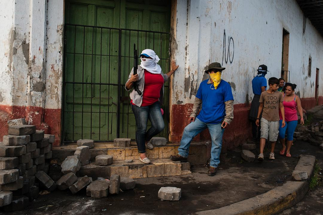 Sandinista militias stand guard at a dismantled barricade after police and pro-government militias stormed the Monimbo neighborhood of Masaya, Nicaragua. Heavily armed police and militias laid siege to and then retook the symbolically important neighborhood that had recently become a center of resistance to President Daniel Ortega's government.