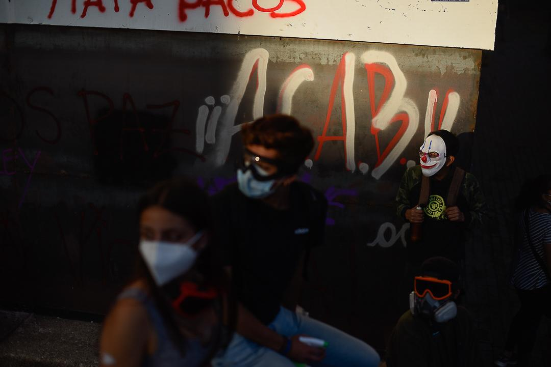 demonstrators cover their faces with masks to protect themselves against covid-19 as they protest against the chilean state to demand and claim their rights.