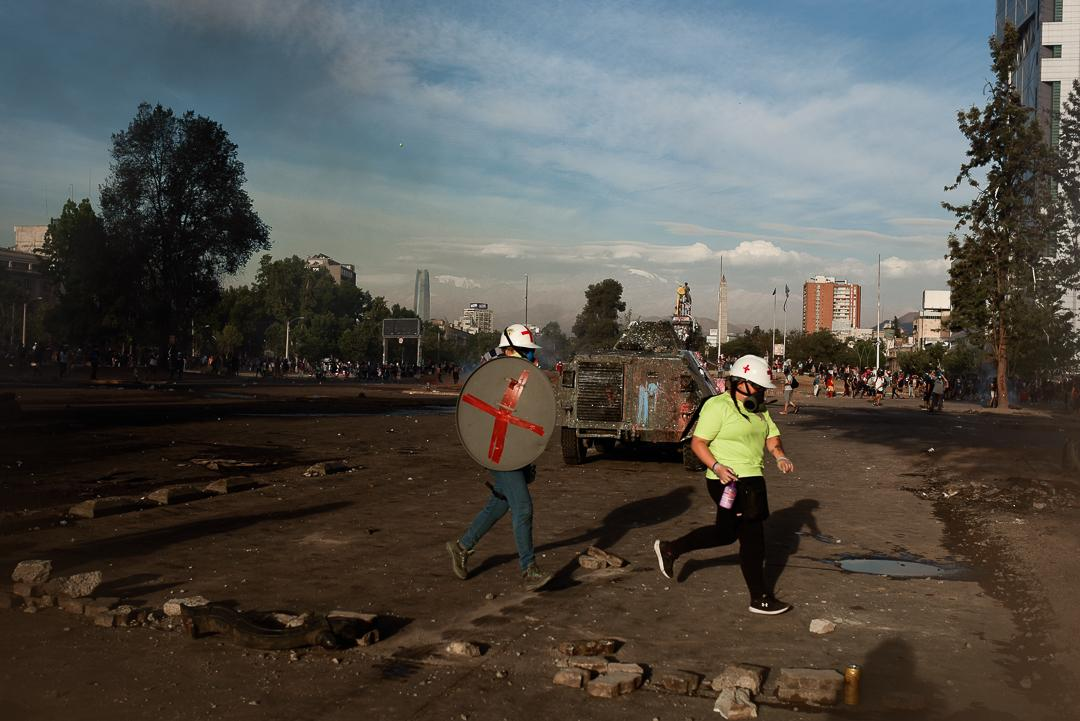 first-aid rescuers pass through the barricades