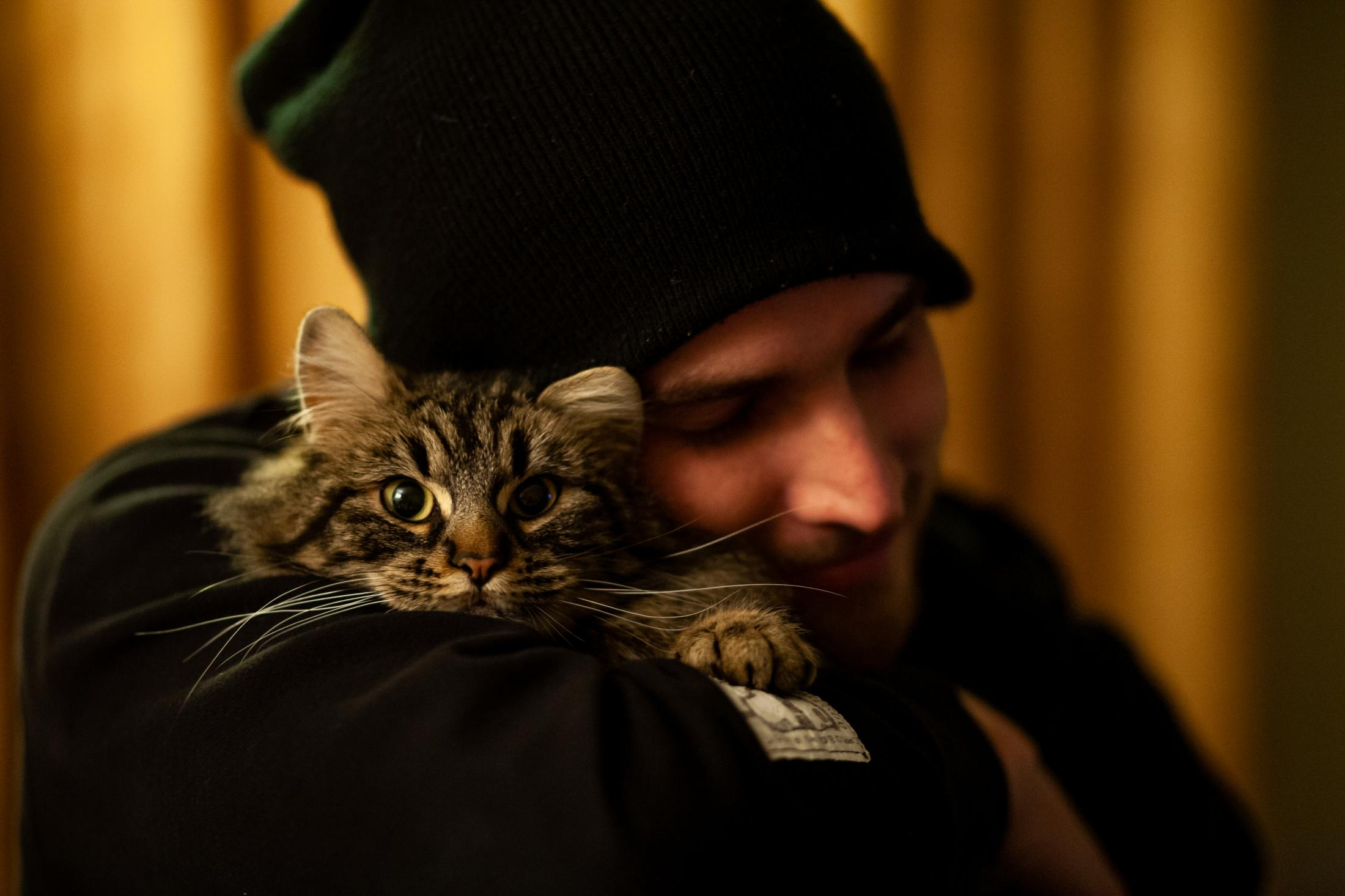 2/28/14- North Dakota - Adam Braun holds a stray cat tight that he rescued from the winter blizzard. The cat served Adam as a companion during the lonely days working in Wolf Point, Montana.