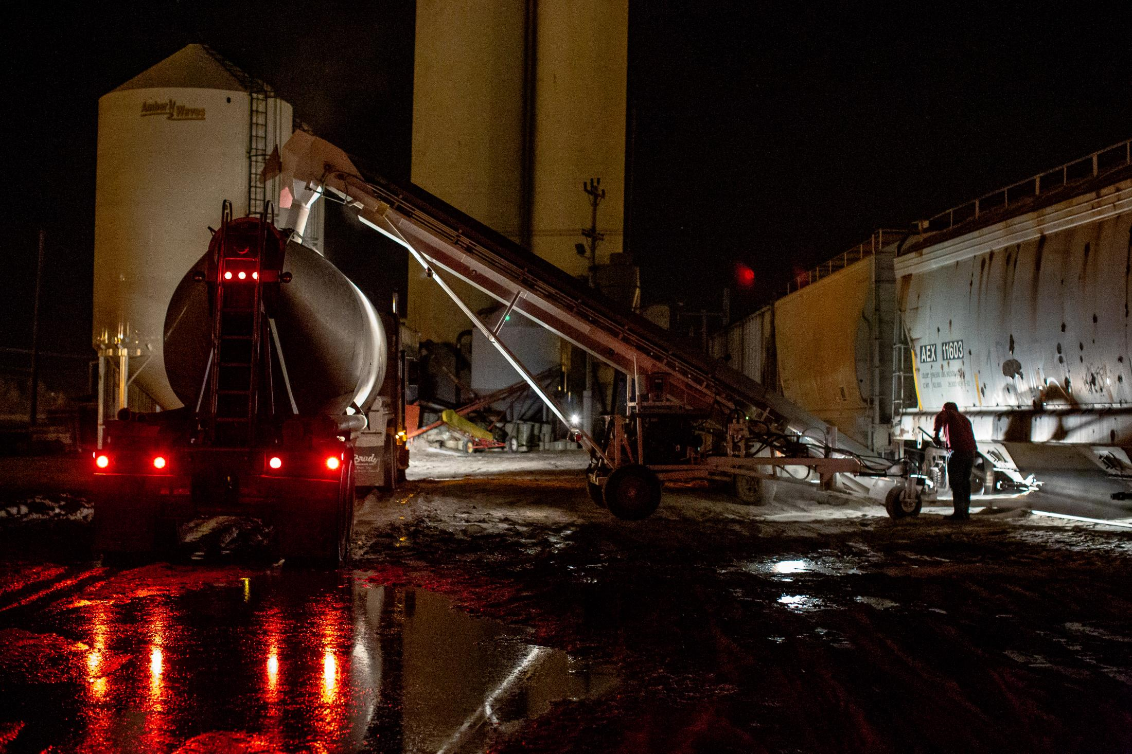 4/3/14- North Dakota - Adam Braum opens a railcar hatch with thousands of pounds of frac sand. The frac sand is then sent up a conveyor belt and poured into the truck. During the winter months, railcar hatches can freeze and the sand inside as well. Workers are instructed to use a wheat burner to defrost the hatch.
