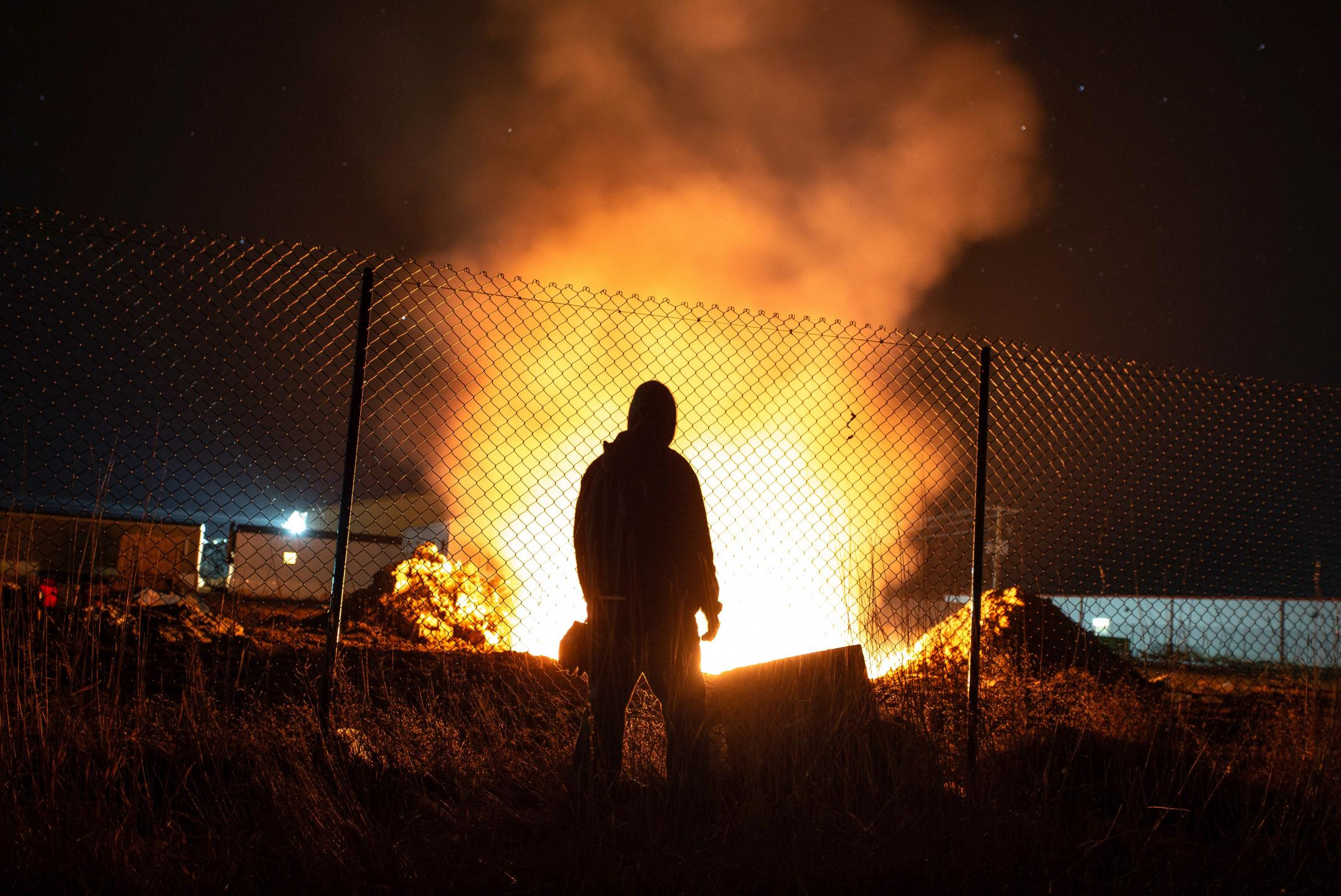"""4/17/15- North Dakota - A resident looks at a flame started by an oil company; he grows frustrated as the smoke from the burning frac bags hits his house. Many locals don't want the oil fields in North Dakota. Nicknames for workers like """"Oil Field Trash"""" has been used to describe the outsiders coming in."""