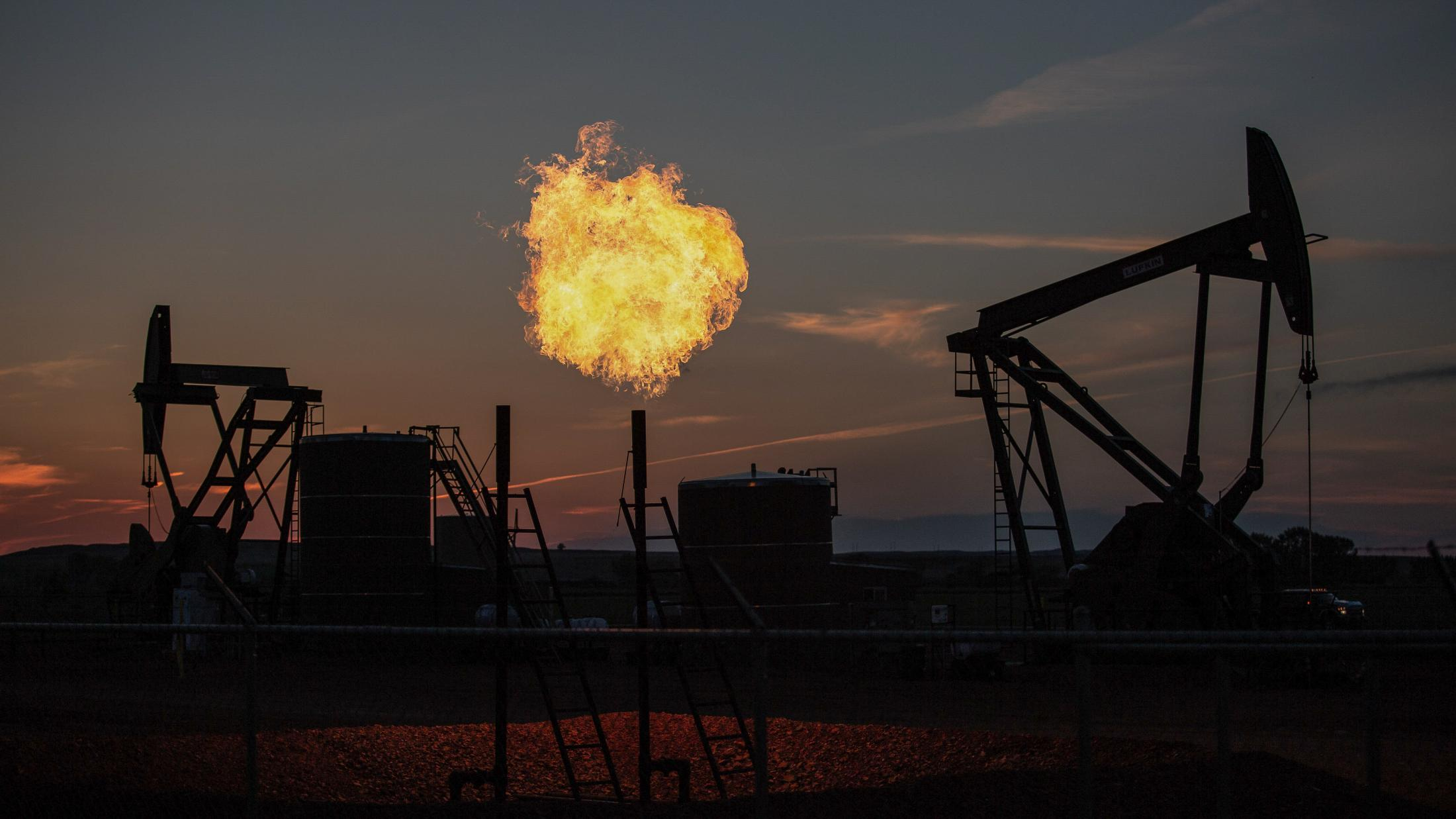 5/31/15- North Dakota - A fireball explodes from a natural gas pipe on a well site; gas is burned to save oil companies' money.
