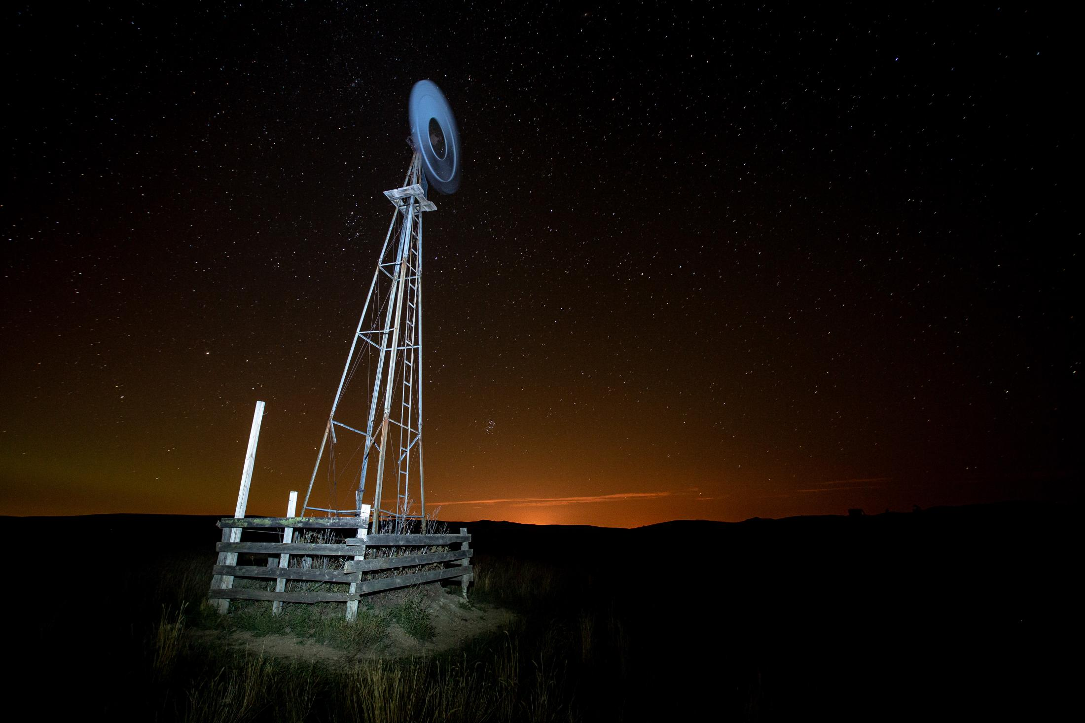 9/23/14- North Dakota - Orange lights aluminate the night sky. The source from this light is thousands of natural gas flames. These flames are located on well sites producing oil and burn the gas instead of collecting it.