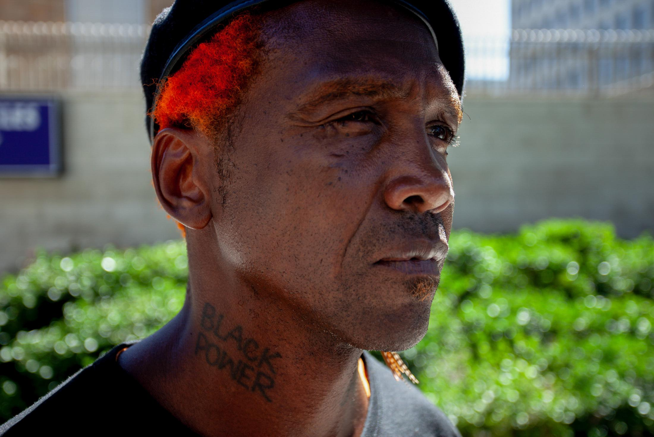 General Jeff, A Los Angeles activist, and Skid Row Advocate pose for a portrait.