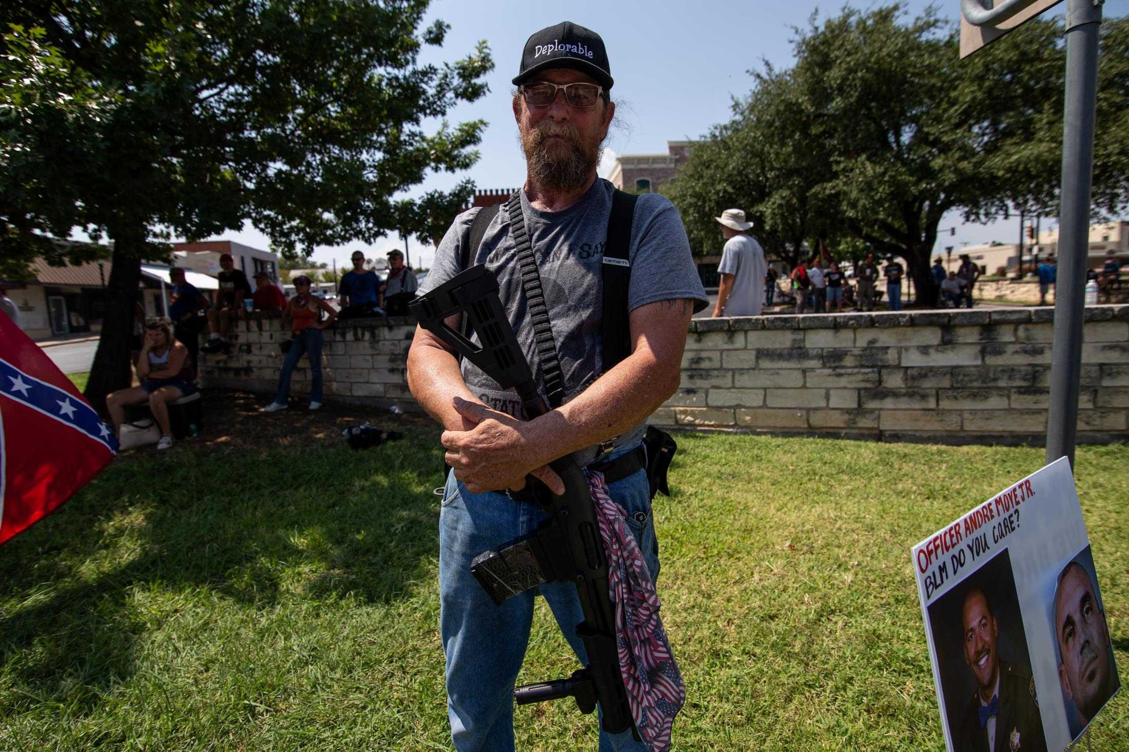 George, 66, from Mineral Wells, Texas, stands on the side of the Weatherford Confederate monuments supporters, armed with a rifle. He brought his weapon to protect himself as the demonstrators have brought their guns.