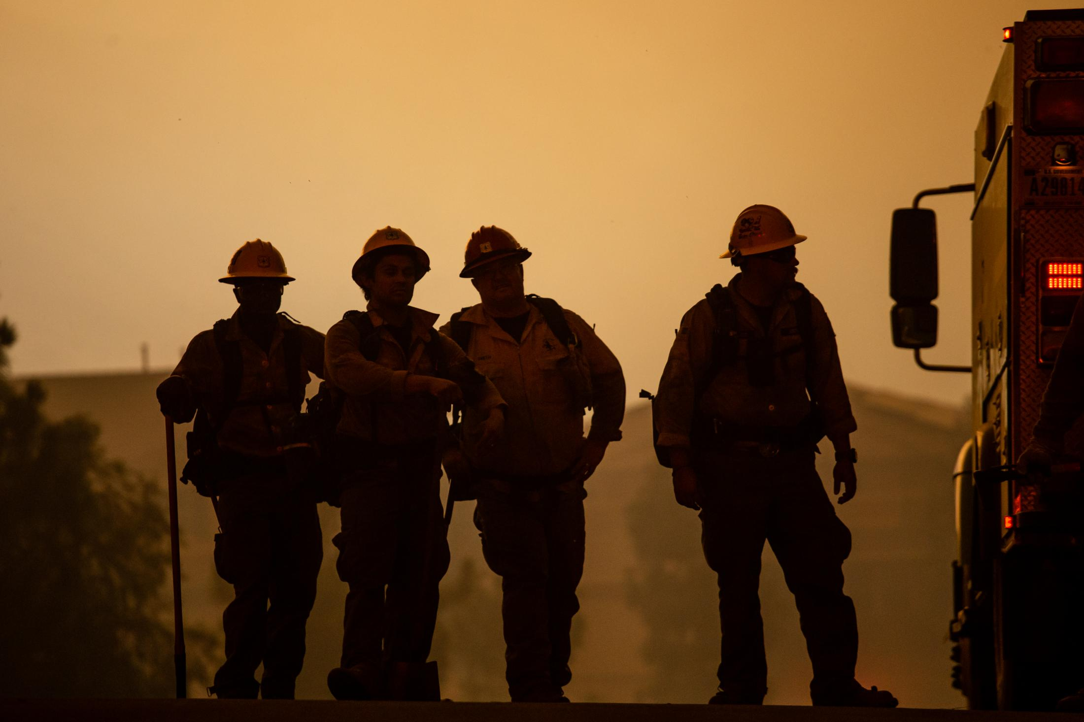 A group of firefighters from Texas gathers together when arriving at the frontline of the wildfire. Many outside departments have volunteered to help California battle the blaze.