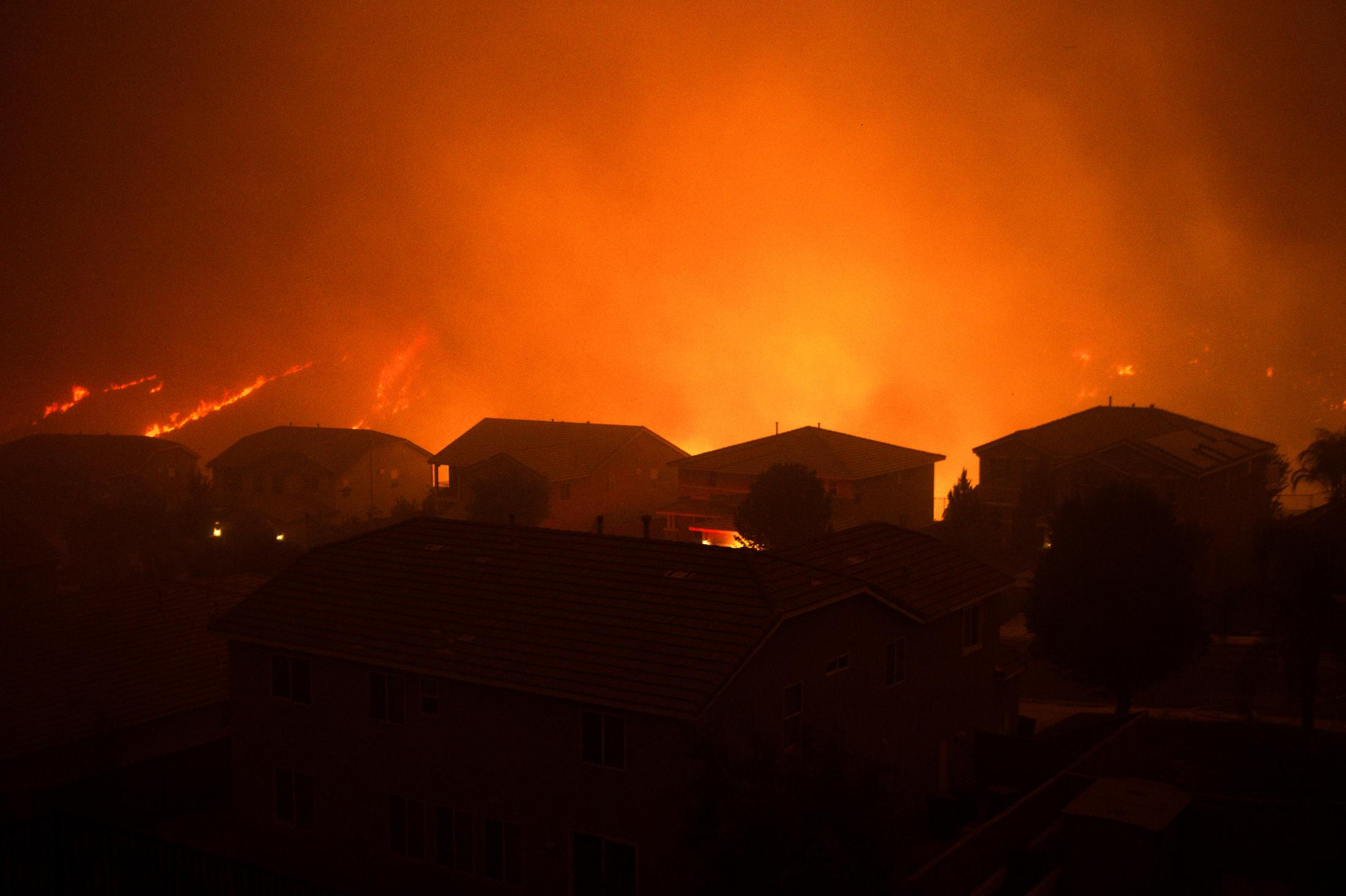 A neighborhood sits in the path of destruction as a violent wildfire destroys anything in its way.