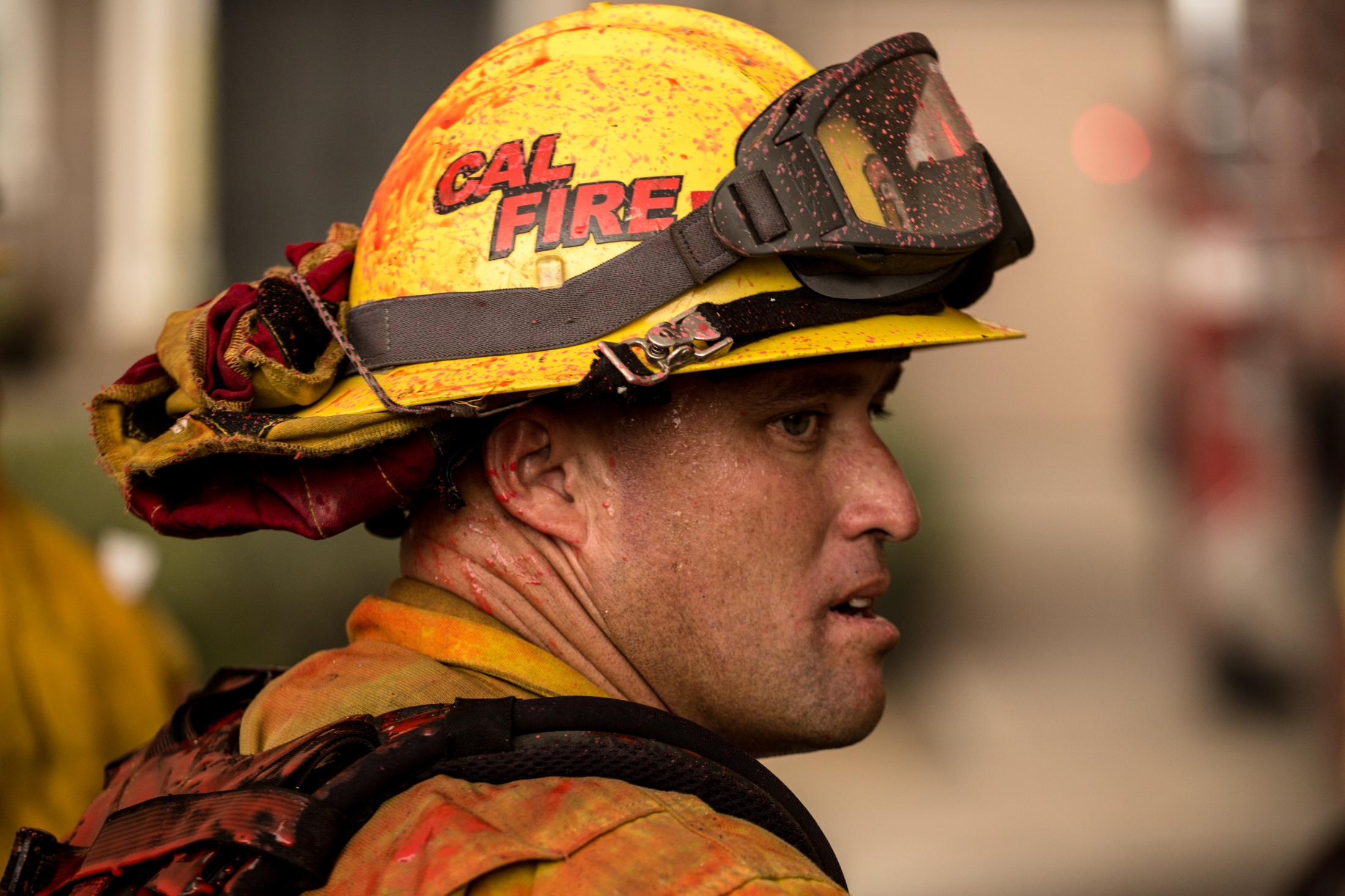 A portrait of a CALFIRE fighter as he comes off the fireline. Firefighters spend hours battling the violent wildfire.