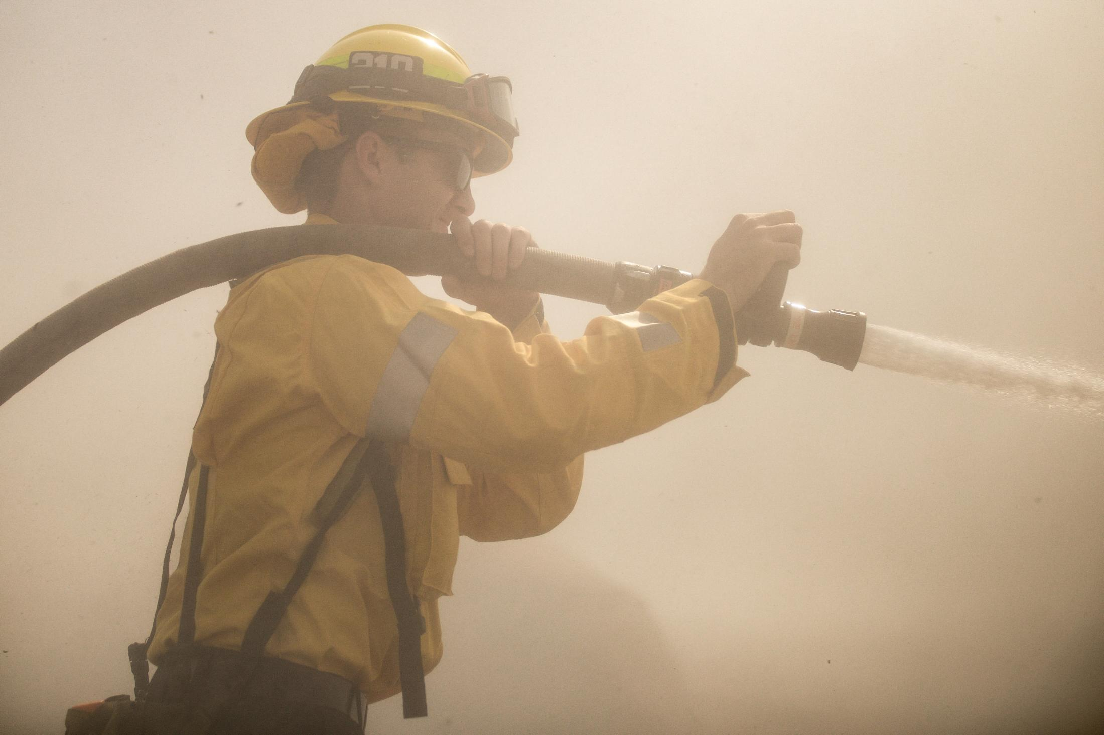 The state of California faced its worst fire season in history. One of the worst fires located in Los Angeles and Ventura County, named the Woolsey Fire. This wildfire burned; 96,949 acres and destroyed 1,643 structures. Three people reported to have died in the blaze, and over a quarter-million evacuated. A water cannon is sprayed at a hotspot in the effort to contain a hazardous fire area.