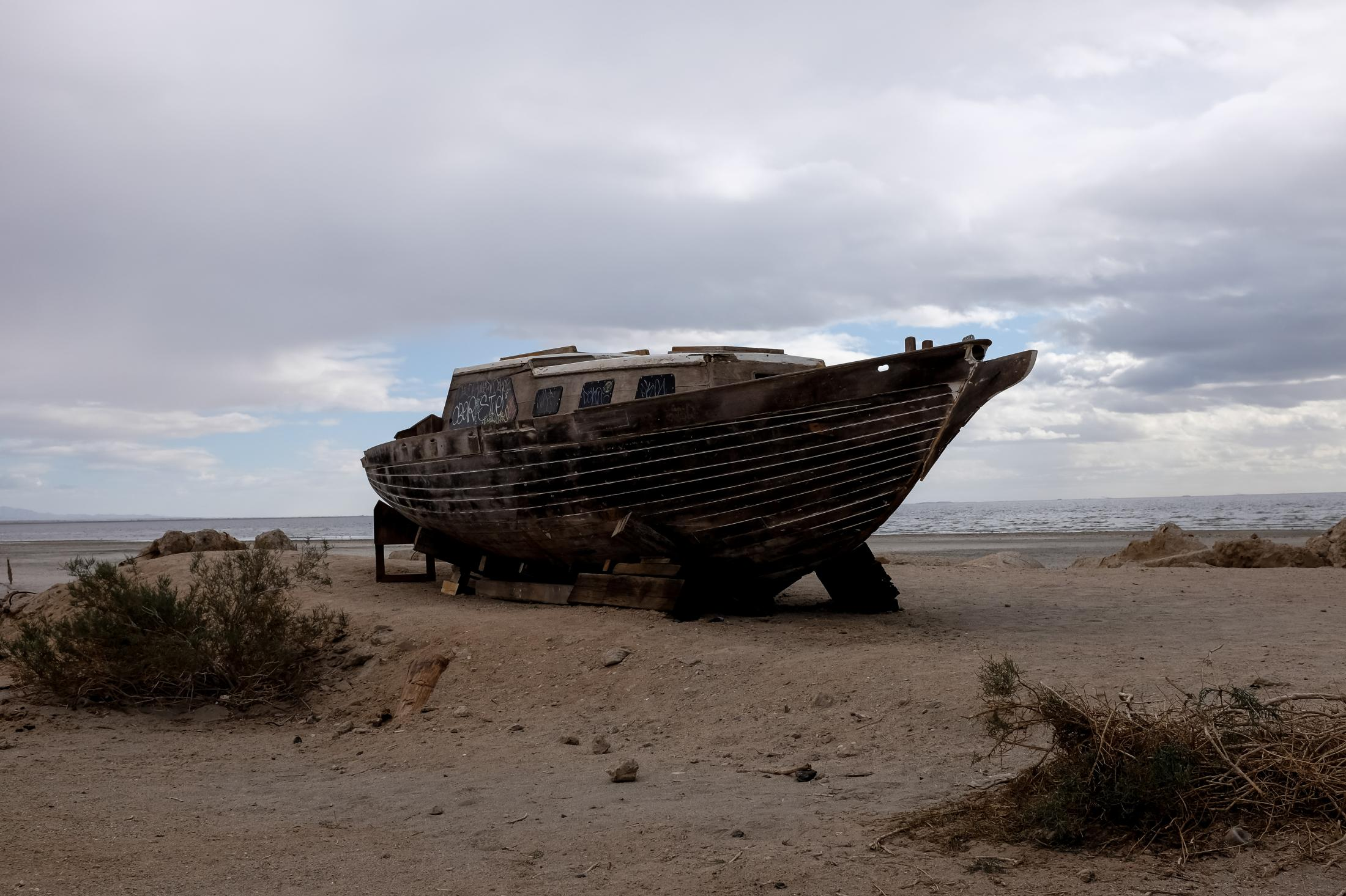 11/27/16-California - The remains of a sailboat left docked on The Salton Sea's desert beaches, once populated with summer vacation homes and resorts. It is mostly abandoned with just memories of the past.