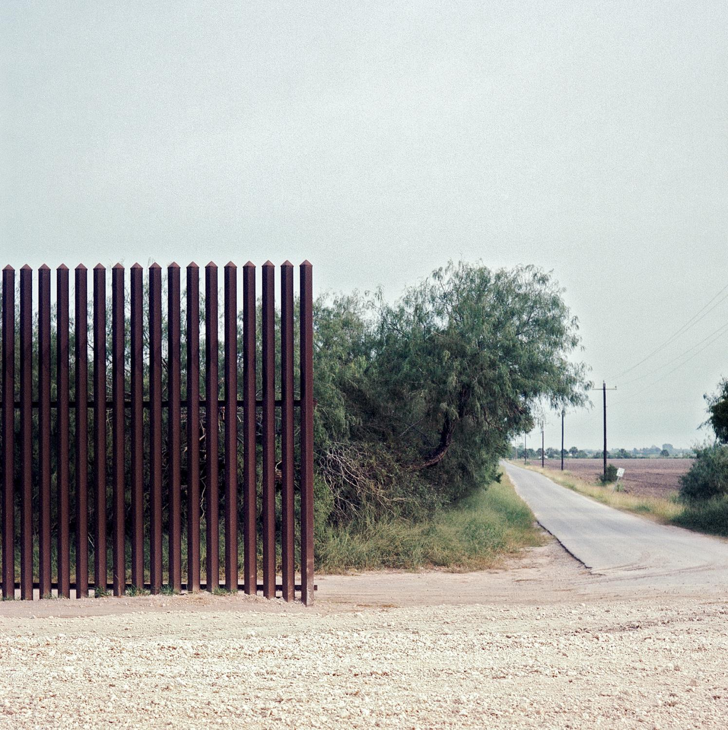 Brownsville, TX - OCTOBER 16, 2020: The U.S.-Mexico border fence stops at a road. The fence is located less than a mile away from the Rio Grande.