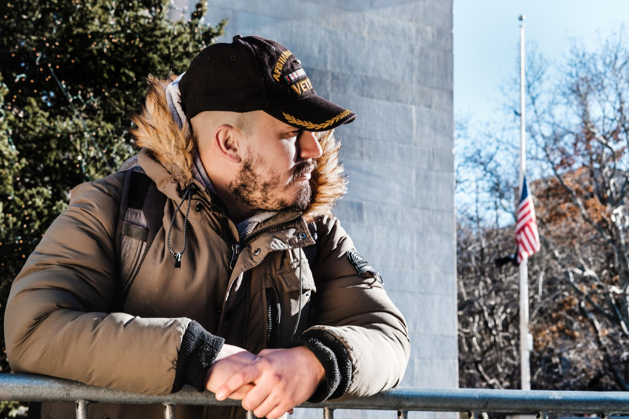 "Washington Square Park, New York University, NY. December 7, 2018. ""I received direct and indirect enemy contact while on foot patrol and reacted in order to deter the threat. What serving means to me is the courage to confront my fears."" James reflects on his time in the service."