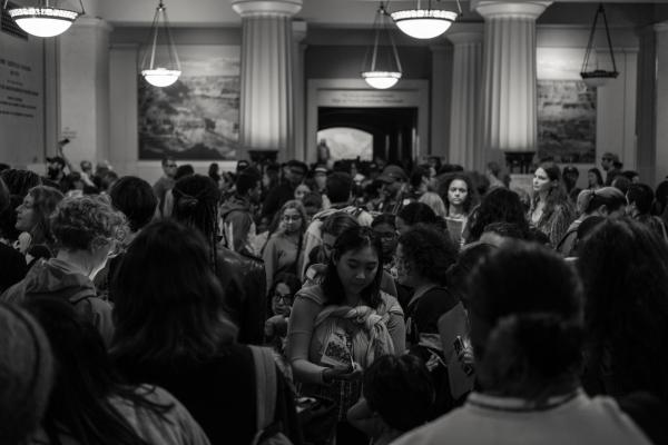 New York City, NY - October 8, 2018. Indigenous Peoples Day, 2018. 3rd Anti-Columbus Day Tour at American Museum of Natural History. A large crowd joined inside the Theodore Roosevelt Memorial Hall for an orientation meeting. Credit: Andres Guerrero