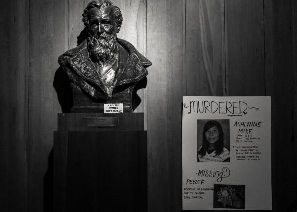 New York City, NY - October 8, 2018. Indigenous Peoples Day, 2018. 3rd Anti-Columbus Day Tour at American Museum of Natural History. Some of the museum's exhibits like the bust of Jhon Muir, were redecorated in protest fashion by event organizers. Credit: Andres Guerrero