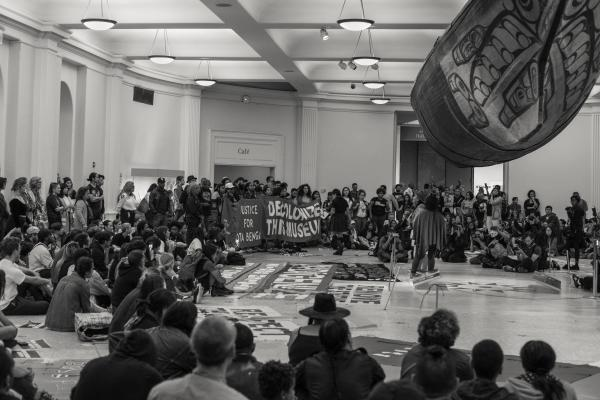New York City, NY - October 8, 2018. Indigenous Peoples Day, 2018. 3rd Anti-Columbus Day Tour at American Museum of Natural History. Decolonial gathering inside of the Grand Canoe exhibit. Credit: Andres Guerrero